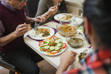 Family Eating Indian food Together