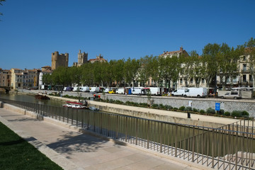 A street and canal in the center of Narbonne, France