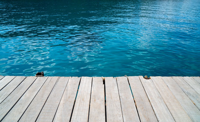 empty wood desk and summer blue sea background .Blank space for text and images.