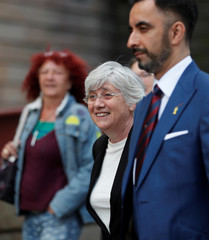 Catalunya's former Education Minister Clara Ponsati and her lawyer Aamer Anwar arrive at the Sheriff Court in Edinburgh