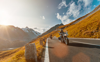 Motorcycle driver riding japanese high power cruiser in Alpine highway on famous Hochalpenstrasse, Austria.
