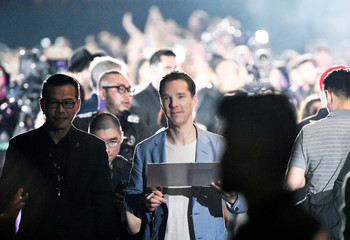 Cast member Benedict Cumberbatch holds a fan's artwork as he walks the red carpet during a fan event for Marvel Studio's Avengers: Infinity War movie, in Singapore