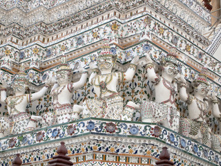 Giants on the wall of the Wat Arun temple, Thailand