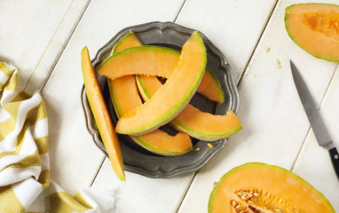 Fresh sweet cantaloupe melon on the wooden table.
