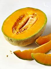 Fresh sweet cantaloupe melon on the white background.