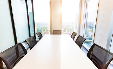 Modern meeting room with for present, large windows outside building, city, tower view, soft focus