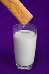 glass of milk with a cookie