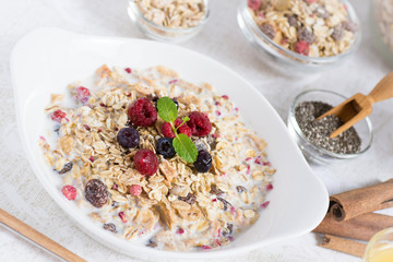 Sunny Morning with Healthy Breakfast. Muesli With Milk, Chia Seeds, Berries and Cinnamon.