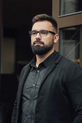 bearded boy in glasses