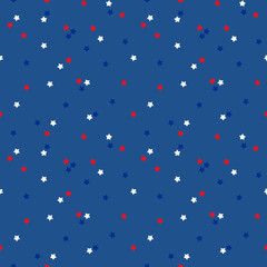 Seamless pattern background with stars in USA flag colors, suitable for national american holidays design.