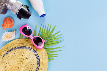summer set top view,outfit and accessories of traveler on blue  background with copy space, Travel concept.Overhead view of Traveler's accessories, Essential vacation items,