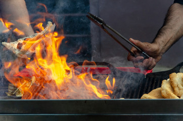 Barbecue grill fire with hands