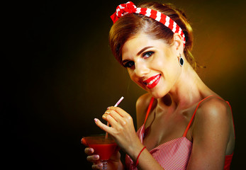Pin up girl drink bloody Mary cocktail. Pin-up retro female style. Girl wearing red dress seduces men. How to choose room for retro party. Photos on dark background. Favorite girl on date.