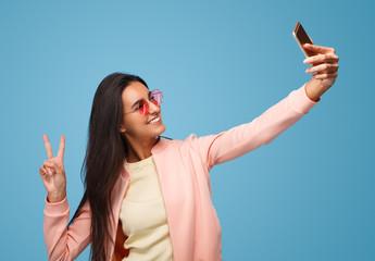 Casual woman posing for selfie