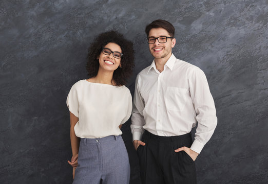 Happy business couple on gray background