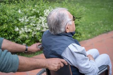 Disabled senior man in wheelchair outdoor