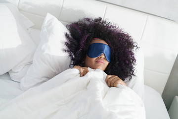 Tired Black Girl Waking Up In Bed With Sleep Mask