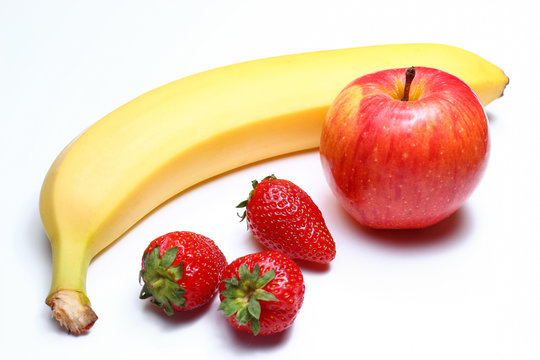 Apples, strawberries and banana on a white background