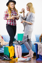 Two female friends after shopping