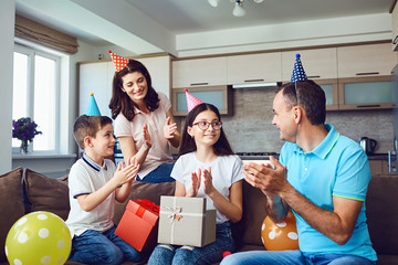 Happy family with cake on birthday party.