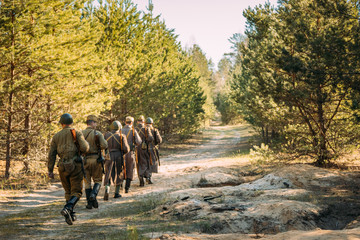 Group Of Re-enactors Dressed As Soviet Russian Red Army Infantry