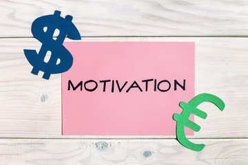 Motivation for earning growth concept on wooden table.