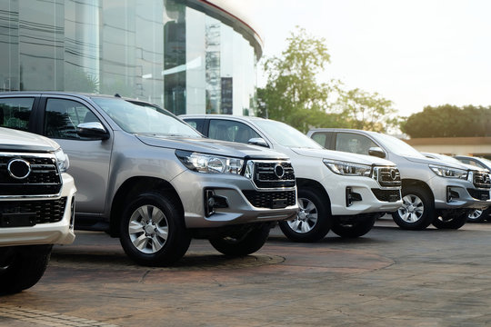 Row of New Pickup Trucks For Sale