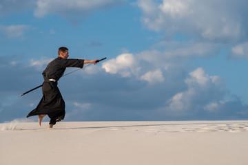 Expressive man practicing Japanese martial art