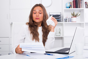 Young female experiencing problems at work office