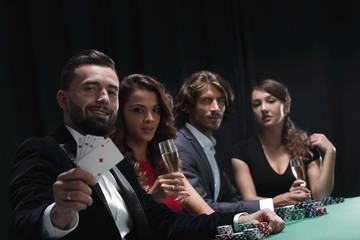 celebrating victory in poker with champagne.