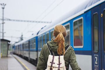Woman boarding to train at the railway station
