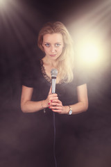 beautiful singer sings the song in the spotlight