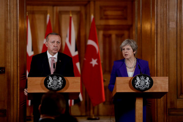 Turkey's President Recep Tayyip Erdogan and British Prime Minister Theresa May take part in a news conference after their meeting at 10 Downing Street in London