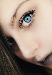 Beautiful girl with beautiful eyes portrait close up