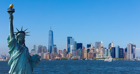 The statue of Liberty with World Trade Center background