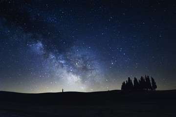 The Milky Way on the cypress trees of San Quirico d'Orcia
