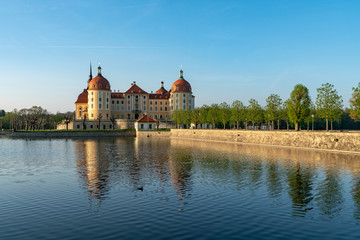 Castle Moritzburg in Saxony near Dresden. Pond reflection. Springtime. Germany.