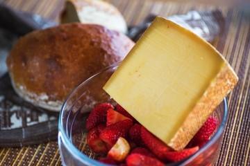 Gruyere cheese, strawberry and bread.