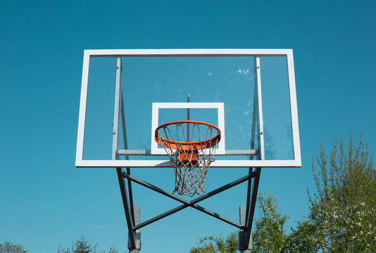 Basketball hoop outdoor on blue sky background - sports