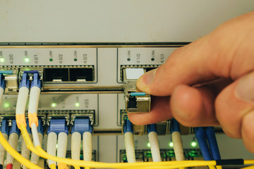 Installing the sfp module in the central router port in the data center server room. Creating a high-speed Internet connection