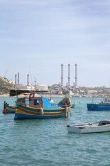 Traditional colorful fishing boats at Marsaxlokk Harbor, Malta