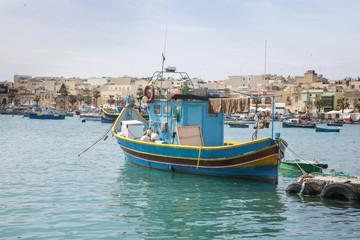 Traditional colorful fishing boats at Marsaxlokk Harbor, Malta