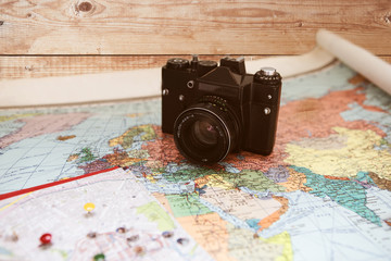 Photo camera on the map. Travel concept