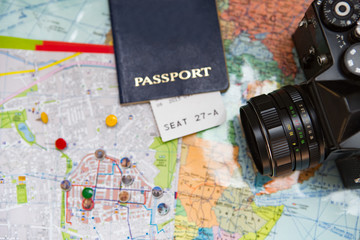 Photocamera and passport on the map.Travel concept