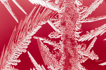 Red drawings on the glass in the frost
