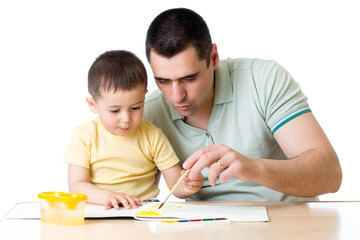 Dad and kid son playing with paint colors