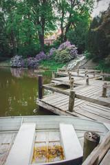 Wooden bridge near lake in city park