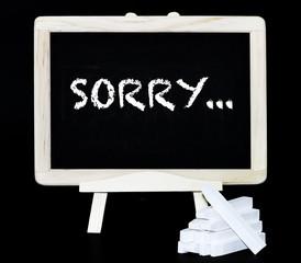 Sorry symbol on a blackboard