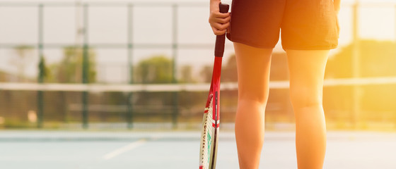 Tennis player holding racket preparing for playing game on outdoor court