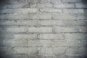 Gray wall made of aerated concrete blocks, seamless background photo texture.